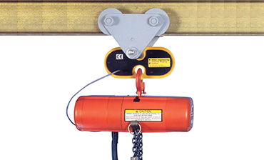 Electro-mechanical overload detector installed above a hoist
